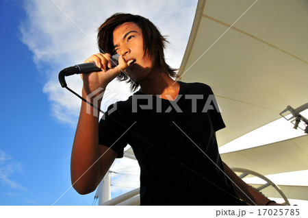 asian young rock star in action